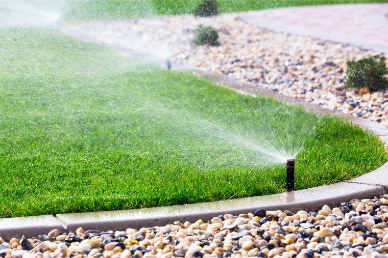 Water sprinklers keeping lawn healthy.